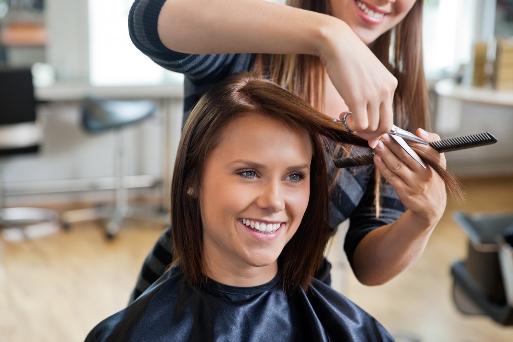 woman getting hair cut in salon