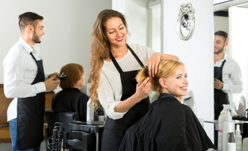 hair stylist working in salon