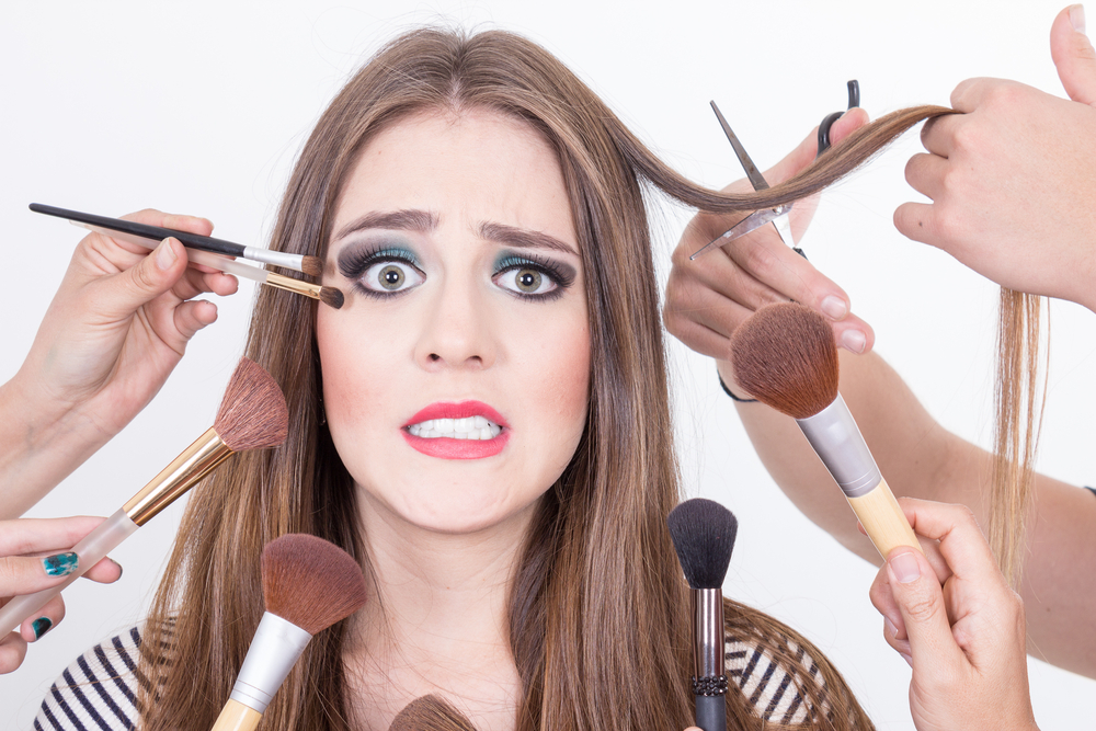 woman overwhelmed by cosmetology tools